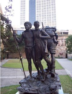 Statue in Brisbane, Australia of Raphael Aimbari, an Oro man, leading a blinded Australian soldier during the New Guinea Campaign