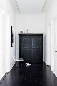 Polished black floorboards