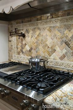 Backsplash highlights a Viking cooktop