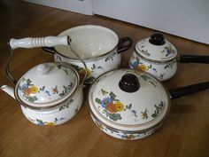 Enamel Pots and pan set with tea kettle by Traincasesandmore on Etsy https://www.etsy.com/listing/243366318/enamel-pots-and-pan-set-with-tea-kettle