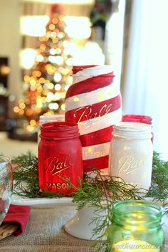 DIY candy cane striped painted mason jar centerpiece