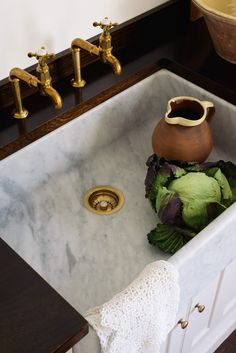 """As with all Carrara marble products, it's not for those who want immaculate surfaces forever,"" the company notes. The stone, like old Italian kitchen sinks, is meant to age with use."