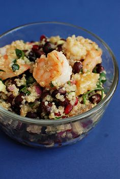 Colorful Shrimp and Quinoa Salad. Made this. Sooo good and addictive. Be sure to add corn. And I did it without the pomegranate.
