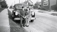 Photo of Frank Modrowski and fiancee Jen Reidel on a 1941 Plymouth Deluxe. The photo was taken in Kitchener, Ontario during the summer of 1941 while Frank was on leave with the Canadian Army.