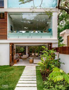 À sombra do Cristo, casa une essência moderna e contemporânea - Casa