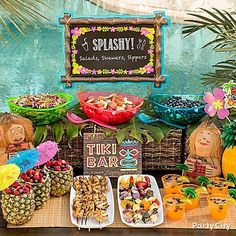 Here a tiki-rific table spread!  We've got a menu full of salads, skewers, plus decorating tips!
