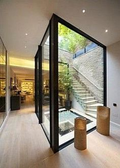atrium . basement conversion for terraced new house . South End, London . Builders GB