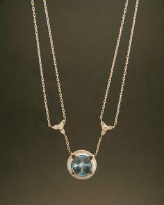 blue topaz and diamond eos necklace