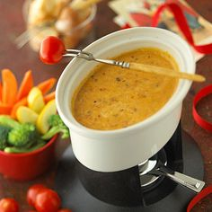 Mexican Fondue.. wow.. this would be good!!        ..a mixture of spicy chorizo sausage, chipotle peppers, and lots of melted cheese makes the perfect dip for toasted bread cubes, fresh vegetables, and tortilla chips.