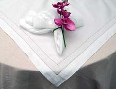 Swiss Dot Tablecloth & Napkin by Boutross Imports.  Features exquisite Madiera style cutwork and swiss dot embroidery