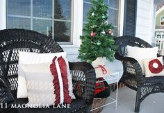 Pretty outdoor Christmas decor on porch--some great decorating ideas for the holiday. by Lee Ann Swift