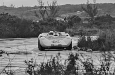 Hap Sharp drives the # 66 Chaparral during the wet 1964 Nassau Trophy race. Roger Penske was driving the # 65 Chaparral, but a broken suspension sidelined the car. Later in the race, while in the lead, Sharp generously turned over his car to Penske, who drove it home for the victory. Eric della Faille photo.