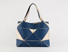 A foldable tote is dressed up in gleaming gold and brilliant blue.