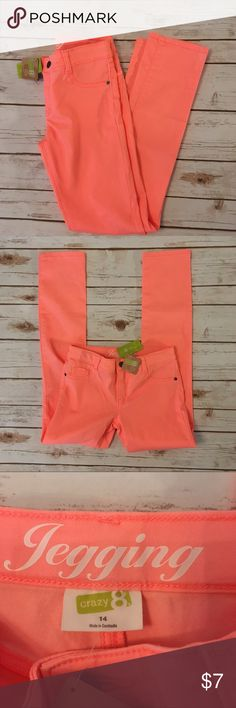 NWT Girls Jeggings Pretty orange/peachy color. 62% cotton, 35% polyester, 3 % spandex. Jeggings with button/zipper closure. Front and back pockets. Crazy 8 Bottoms