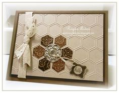 handmade quilt card ... neutral colors ... honeycomb embossing folder ... one flower of hexagons filled with brown patterned paper ... lovely design ... hand crafted card from Birgit ... dots stenciled on for background texture in the middle of the card ... die cut daisy top on stamped stem ... sentiment of top of that ... kraft base ... delightful ... Stampin' Up!