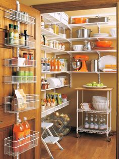 For a kitchen pantry that fits your every need and makes use of all available space, combine a moveable cart and behind-the-door storage.