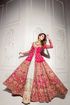 There is a shade of red for every woman. Our classic red bridal couture has just the right amount a traditional touch mixed with… Indian Wedding Gowns, Pakistani Wedding Outfits, Indian Bridal Outfits, Indian Bridal Lehenga, Indian Gowns Dresses, Indian Bridal Wear, Pakistani Wedding Dresses, Indian Designer Outfits, Red Lehenga