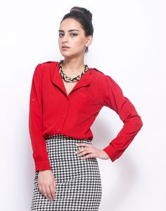 FabAlley - Lady In Red Shirt  Supremely classic deep red crepe shirt featuring a drop collar, shoulder tabs and single front pocket. Optional tab for rolled up sleeves.  Work It - Looks office ready with a houndstooth print pencil skirt and a sleek gold tone necklace.