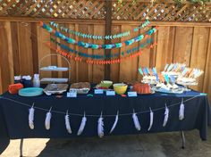 Triangle, arrow, and feather garlands for Aztec/tribal themed baby shower