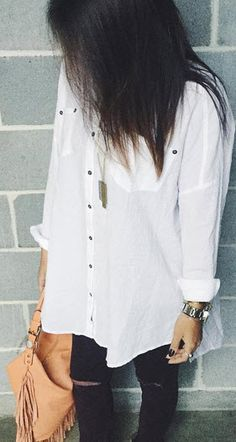 This simple, oversized Free People top is versatile in so many ways. Wear with destructed or clean denim, tuck it, tie it or leave it unbuttoned with a solid top underneath.