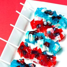Red, white and blue jello shooters for 2012 Super Bowl...or every 4th of July!     By Jelly Shot Test Kitchen, inspired by the Midori Sour Rock Candy Jelly Shooters on Naomi's Bakers Royale blog.    The nubby rock candy effect is achieved by setting and dicing part of the gelatin, then binding it with more liquid gelatin– ingenious!