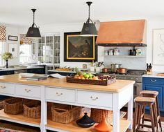A traditional kitchen with wood accents and cabinetry painted in Farrow & Ball's Hague Blue | archdigest.com