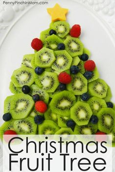 Christmas Fruit Tree - Healthy Holiday Party Treat Idea - - A Christmas fruit tree is a simple way to include healthy foods at your next holiday party spread. Easy to make no matter your age. Christmas Party Snacks, Christmas Brunch, Christmas Appetizers, Christmas Fruit Ideas, Christmas Desserts, Christmas Trees, Party Appetizers, Kids Christmas, Party Desserts