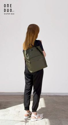 Khaki Green Diaper Bag  An urban minimalistic unisex diaper backpack, functional for every-day use. This backpack has room for everything we believe is important to have when leaving the house with your baby.  This is our third diaper bag collection. This collection comes in two sizes and has added improvements with a new padded laptop sleeve.  When we became parents we needed a diaper bag. We looked for one that really looked good on both of us and was easy to use. As we couldn't find one…