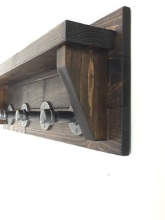 Heres an Iron Pipe Rustic Coat Rack measures approximately 36 Long x 11High x 5Deep. Comes 4 Straight Pipe Hooks. Its built using solid pine wood. We have a variety of Stain choices available. Comes with two pre drilled holes, screws and sheet rock anchors for hanging. Shelf