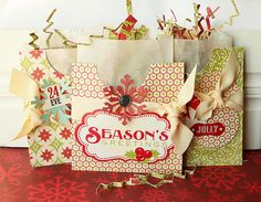 glassine bags in little pouches - a great way to use up my giant stash of Christmas patterned paper!!!