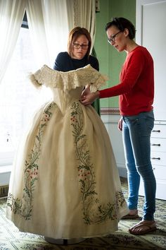 A never before seen dress made for and worn by Queen Victoria is now on display in the Victoria Revealed exhibition at Kensington Palace. The cream silk satin dress, with intricate embroidery, was given to the young Queen in the 1850s by the wife of John Gregory Crace. Beautiful dress....