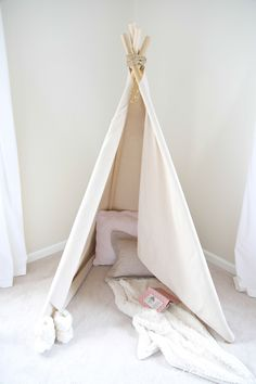 How to make a teepee - an easy no sew teepee tutorial. Get the easy DIY details of this wigwam play tent that's a fun addition for a bedroom or playroom!