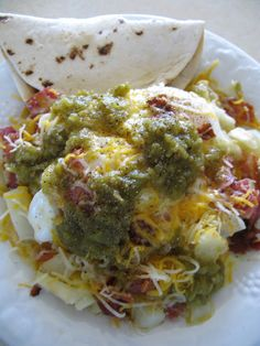 New Mexico Pile-Up. with fried potatoes, eggs, bacon, green chili's, on tortillas topped with cheese and a drizzle of Hot Sauce ! by allisonn New Mexico, Mexico Food, Mexico Style, Mexican Breakfast, What's For Breakfast, Mexican Dishes, Mexican Food Recipes, Chili Recipes, Spanish Dishes