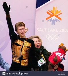 Download this stock image: Figure skater Alexei Yagudin (L) of Russia and his coach Tatyana  Tarasova react to his near perfect scores after his free skating  routine at the Salt Lake 2002 Olympic Winter Games, February 14, 2002.  Yagudin won the gold medal in the competition. REUTERS