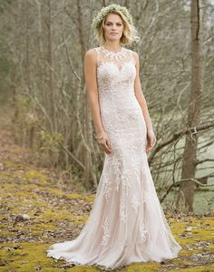 Lillian West lillian west style 6464 The back details of this high neck, fit and flare tulle and lace gown are something special. Lace appliques cover the illusion neckline and back, continue throughout the bodice, and scatter throughout the skirt to the chapel length train.
