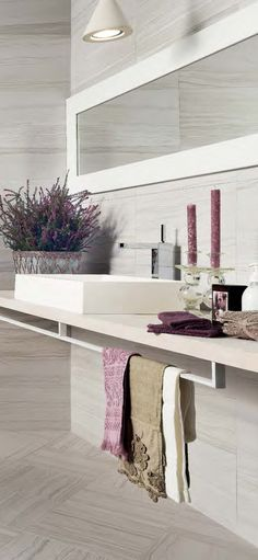 Mixing tile sizes and finishes creates a modern look.