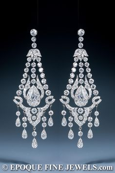 A magnificent early century pair of diamond chandelier earrings, set throughout with old European cut diamonds, centred by a pear-shaped diamond, mounted in platinum and gold. Probably English, circa Total diamond weight: approx 14 ct. Edwardian Jewelry, Antique Jewelry, Vintage Jewelry, Vintage Earrings, Bijoux Art Nouveau, Art Nouveau Jewelry, Diamond Studs, Diamond Jewelry, Pearl Diamond