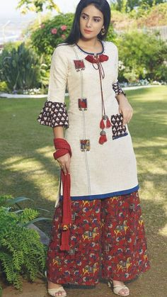 Beautiful linen-cotton kurti with patches and superb detailing.