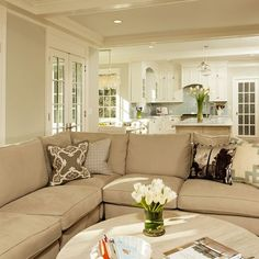 neutral and airy family room best for selling a house for the new family to picture all of their own things in the house.. Neutral is the way