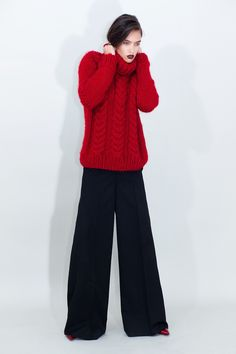This long sleeve cable knit wool sweater is hand knitted from alpaca wool /virgin wool blend. It has a slightly relaxed fit with traditional cable knit coils and a cosy turtleneck collar. Available in two colors: red and blue. Thick Sweaters, Alpaca Wool, Feminine Style, Long Sleeve Sweater, Wide Leg Pants, Cable Knit, Hand Knitting, Wool Blend, Red And Blue