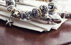 Pandora's Starry Night Bracelet. The mixture of silver, black, and yellow gold is beautiful.