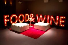 """Downstairs, large marquee letters spelling out """"Food & Wine"""" surrounded a lounge area; the letters were re-used from 2012's Smash-themed..."""