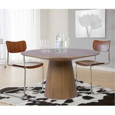 The Errol Dining Chair has a walnut veneered seat and back. It is available in dark walnut and white. $189.00