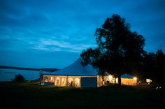 Reception Tent lit up at night- New England wedding - Bar Harbor Sorrento, Maine - photos by top east coast wedding photographers Justin and Mary