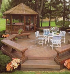 Open, freestanding deck with bench seating plus a screened gazebo with screen doors to escape to when the mosquitoes come out. this is what i would love in the back yard. Gazebo On Deck, Screened Gazebo, Backyard Gazebo, Garden Gazebo, Backyard Landscaping, Landscaping Design, Backyard Ideas, Deck Patio, Deck Benches