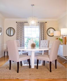 love the chevron curtains and tufted chairs