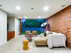 A James Russell home in Brisbane. Loving the continuity of the brick wall and of course the mature Frangipani