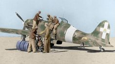 Italian aviators supplying a Macchi mc.202 in Libya - pin by Paolo Marzioli