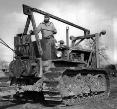 """""""20 year veteran, M/Sgt. Knowles Freeman, Pensacola, Fla., atop a giant bulldozer. He is a member of the 829th Engineer Construction Company building an airport near Eye, England.  (2 Mar 43)"""""""