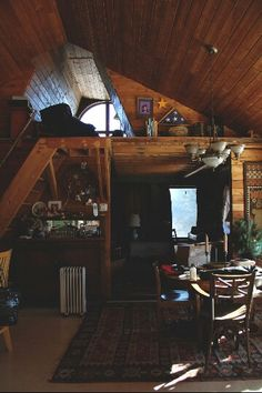 love this space...  wood, loft style, rug...